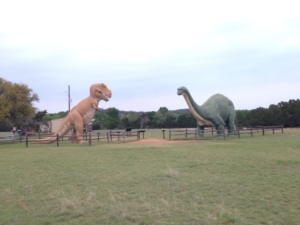 Dinosaurs Playing in the Park